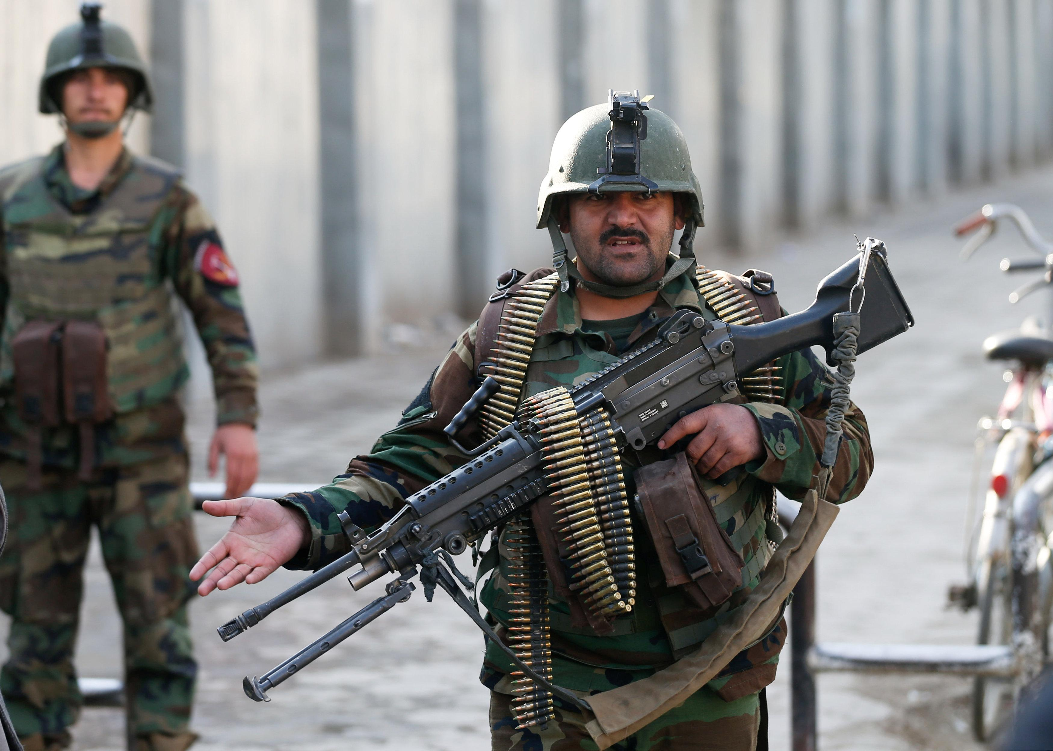 Over 30 killed as gunmen dressed as medics attack Afghan military