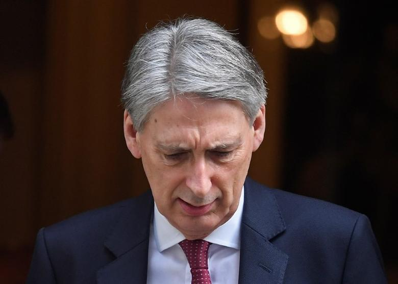 Britain's Chancellor of the Exchequer Philip Hammond leaves his official residence in Downing Street in London, Britain, March 7, 2017. REUTERS/Toby Melville