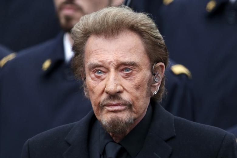 French singer Johnny Hallyday attends a ceremony at Place de la Republique square to pay tribute to the victims of last year's shooting at the French satirical newspaper Charlie Hebdo, in Paris, France, January 10, 2016.  REUTERS/Charles Platiau