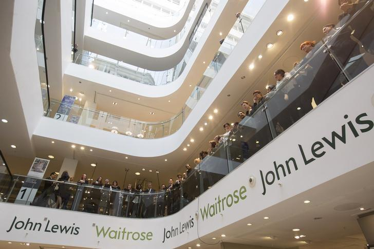 John Lewis and Waitrose employees wait for the announcement of their 2015 bonus in central London, March 12, 2015. REUTERS/Neil Hall