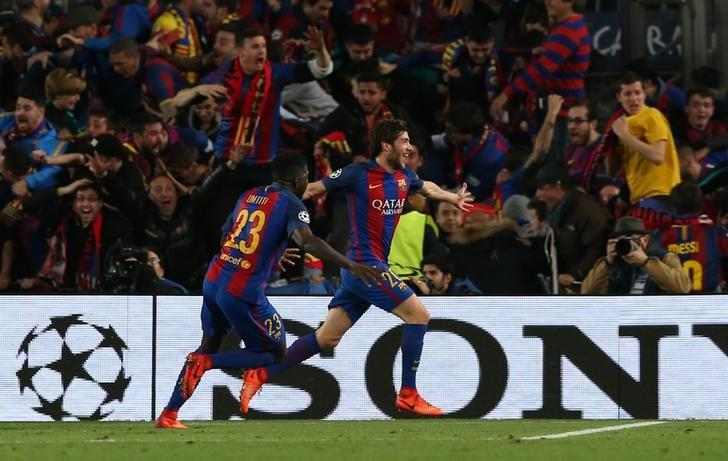 Football Soccer - Barcelona v Paris St Germain - UEFA Champions League Round of 16 Second Leg - The Nou Camp, Barcelona, Spain - 8/3/17 Barcelona's Sergi Roberto celebrates scoring their sixth goal with Samuel Umtiti  Reuters / Albert Gea Livepic