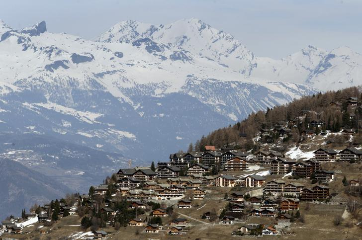 Chalets are pictured in the Alpine ski resort of Veysonnaz near Sion March 10, 2012. REUTERS/Denis Balibouse