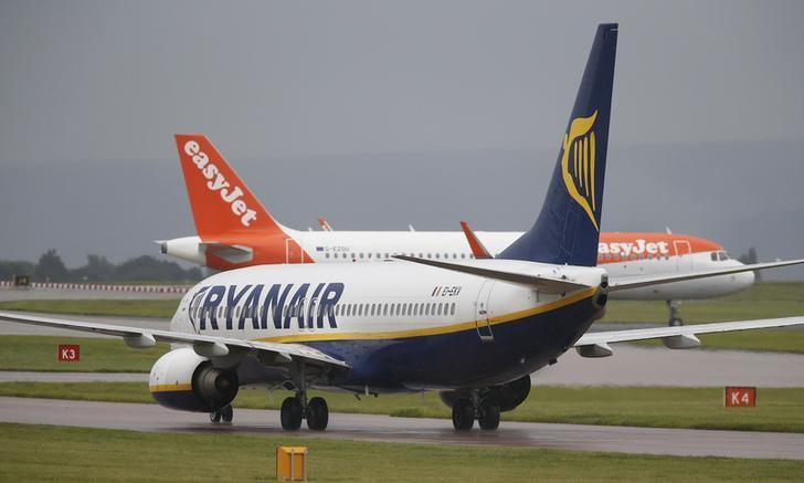 A Ryanair aircraft taxis behind an easyJet aircraft at Manchester Airport in Manchester, Britain June 28, 2016. REUTERS/Andrew Yates/File Photo
