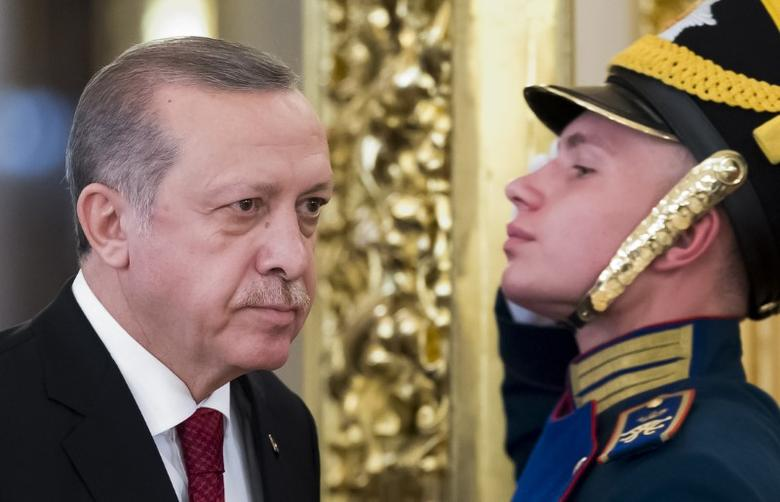 Turkish President Tayyip Erdogan walks past an honour guard during a meeting with his Russian counterpart Vladimir Putin at the Kremlin in Moscow, Russia, March 10, 2017. REUTERS/Alexander Zemlianichenko/Pool