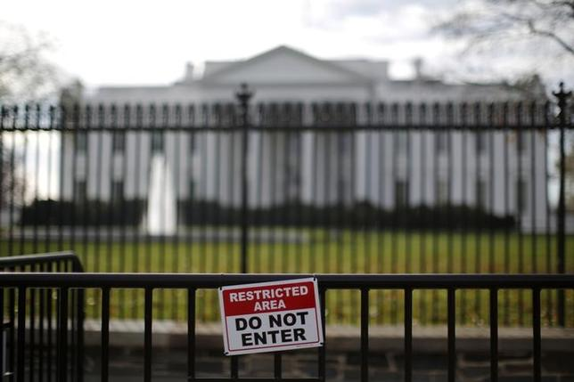 FILE PHOTO: A restricted area sign is seen outside of the White House in Washington November 27, 2015.   REUTERS/Carlos Barria/File Photo