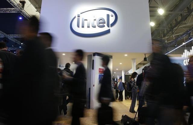 People walk under Intel logo at Mobile World Congress in Barcelona, Spain, February 27, 2017. REUTERS/Paul Hanna
