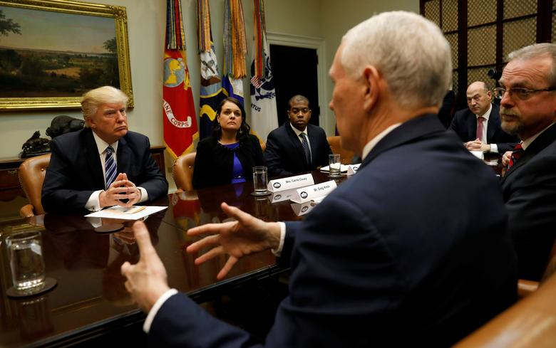 U.S. President Donald Trump listens to Vice President Mike Pence speak during a meeting about healthcare at the White House in Washington, U.S., March 13, 2017. REUTERS/Kevin Lamarque