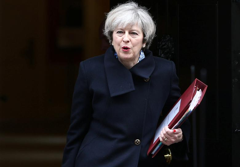 FILE PHOTO: Britain's Prime Minister Theresa May leaves Downing Street in London, Britain March 1, 2017. REUTERS/Neil Hall/File Photo