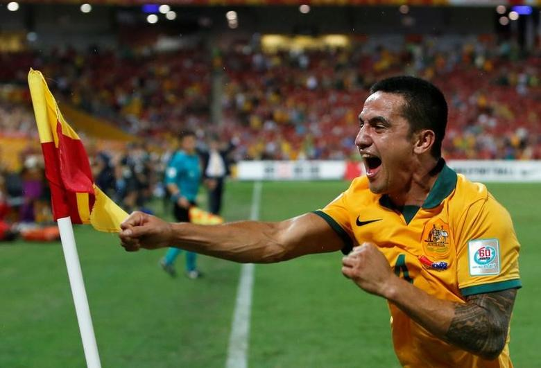 Australia's Tim Cahill celebrates his second goal during their Asian Cup quarter-final soccer match against China at the Brisbane Stadium in Brisbane January 22, 2015.  REUTERS/Edgar Su/File Photo