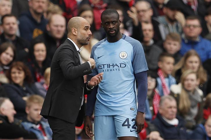 Britain Football Soccer - Middlesbrough v Manchester City - FA Cup Quarter Final - The Riverside Stadium - 11/3/17 Manchester City manager Pep Guardiola and Manchester City's Yaya Toure Action Images via Reuters / Lee Smith Livepic