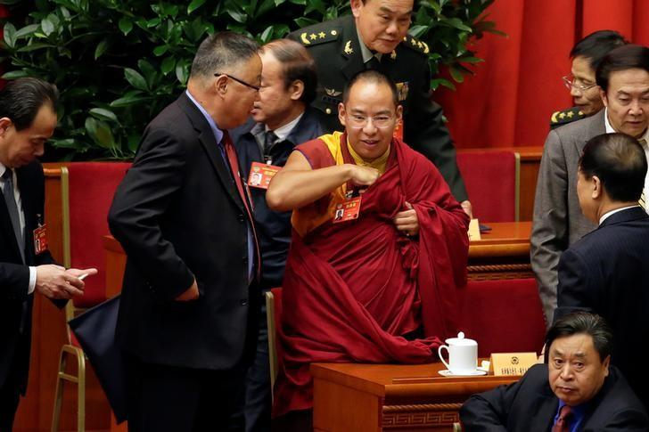 Gyaltsen Norbu, the 11th Panchen Lama and a delegate of Chinese People's Political Consultative Conference (CPPCC), attends the opening ceremony of CPPCC with other delegates at the Great Hall of the People in Beijing, March 3, China, 2017. REUTERS/Jason Lee