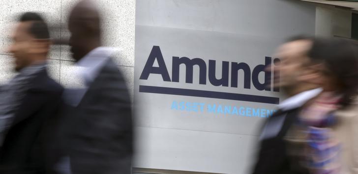 People walk near the Amundi company headquarters in Paris, France, October 7, 2015. REUTERS/Philippe Wojazer