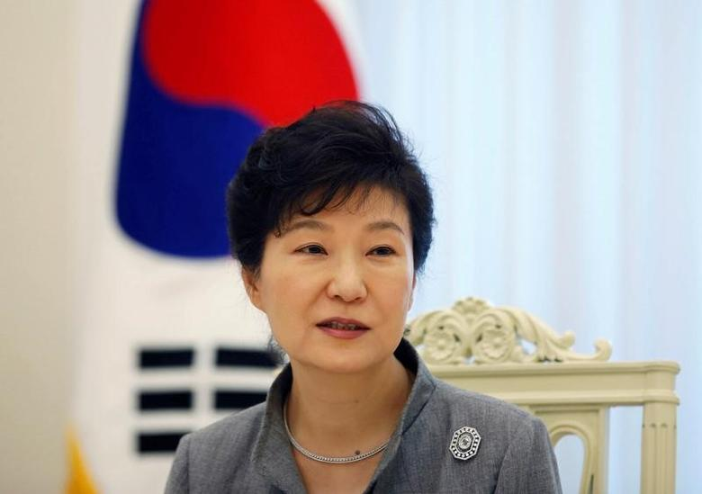 FILE PHOTO:  Park Geun-hye speaks during an interview with Reuters at the Presidential Blue House in Seoul September 16, 2014.  REUTERS/Kim Hong-Ji/File Photo