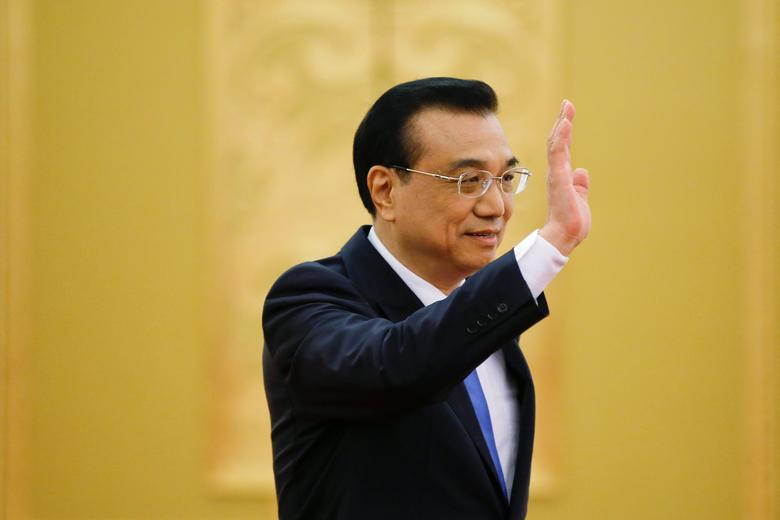 China's Premier Li Keqiang waves as he arrives for a news conference after the closing ceremony of China's National People's Congress (NPC) at the Great Hall of the People in Beijing, China, March 15, 2017. REUTERS/Damir Sagolj