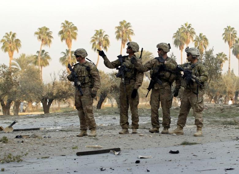 U.S. troops keep watch at the site of a suicide attack on the outskirts of Jalalabad, Afghanistan, January 2015.  REUTERS/Parwiz