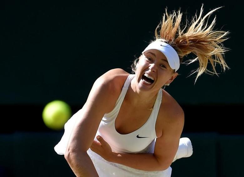 FILE PHOTO -  Maria Sharapova of Russia serves during her match against Serena Williams of the U.S.A. at the Wimbledon Tennis Championships in London, July 9, 2015.       REUTERS/Toby Melville/File Photo