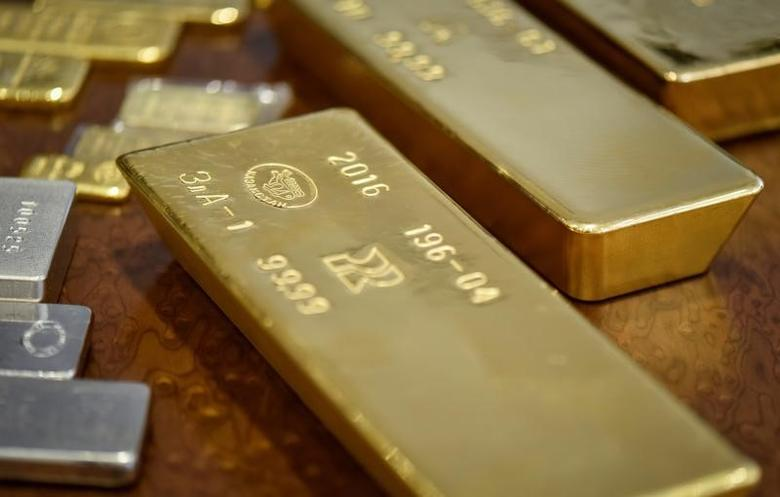 Gold bars imprinted with the word Kazakhstan are seen at the country's National Bank vault in Almaty, Kazakhstan, September 30, 2016.  REUTERS/Mariya Gordeyeva -