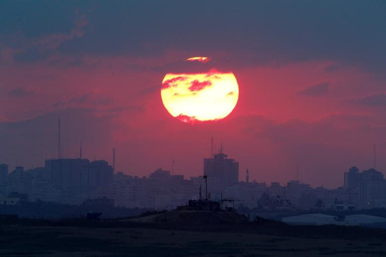 The sun sets over the Gaza Strip, as seen from the Israeli side, September 2016.    REUTERS/Amir Cohen/Files