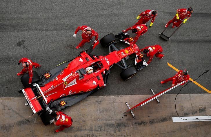Formula One - F1 - Test session - Barcelona-Catalunya racetrack in Montmelo, Spain - 7/3/17. Ferrari's Sebastian Vettel is pushed to the garage.   REUTERS/Albert Gea/File Photo