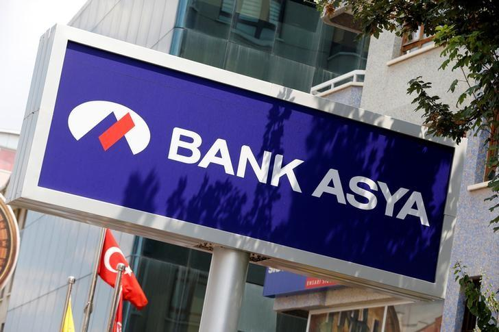 A Bank Asya logo is seen at a branch in Ankara August 12, 2014. REUTERS/Umit Bektas/File Photo
