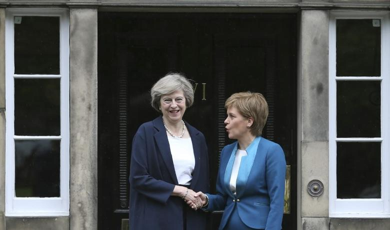 Scotland's First Minister, Nicola Sturgeon (R), greets Britain's new Prime Minister, Theresa May, as she arrives at Bute House in Edinburgh, Scotland, Britain July 15, 2016. REUTERS/Russell Cheyne/Files