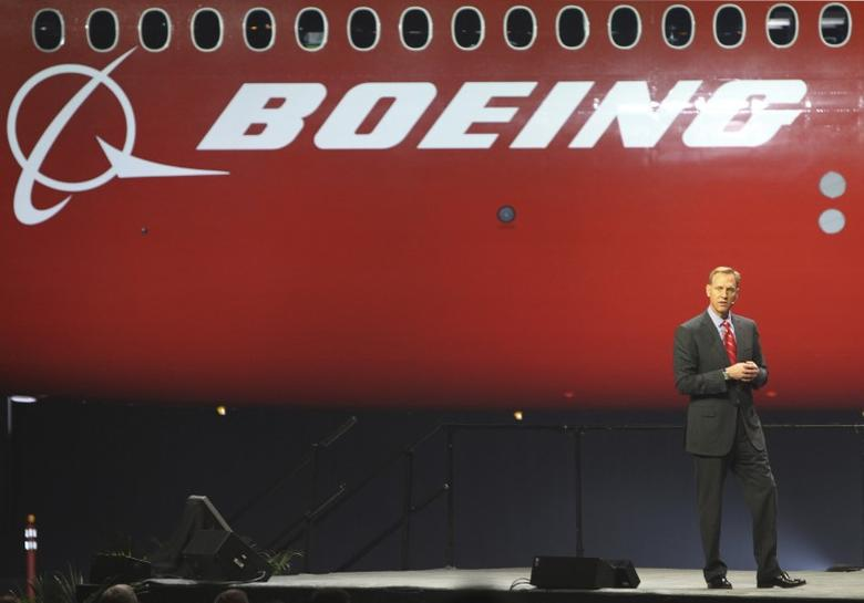 Boeing's Pat Shanahan speaks to thousands of employees and guests, as a curtain is raised to unveil the 747-8 jumbo passenger at the company's Everett, Washington commercial airplane manufacturing facility, February 13, 2011. REUTERS/Anthony Bolante
