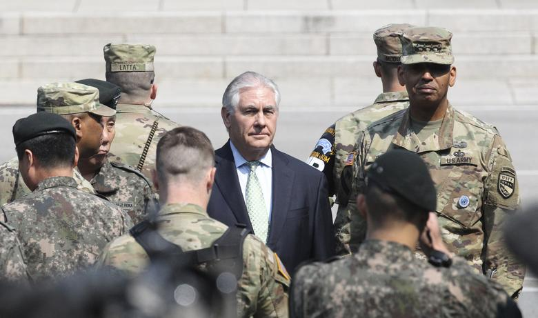 U.S. Secretary of State Rex Tillerson (C) visits with U.S. Gen. Vincent K. Brooks, commander of the United Nations Command, Combined Forces Command and United States Forces Korea (R) at the border village of Panmunjom, which has separated the two Koreas since the Korean War, South Korea March 17, 2017. REUTERS/Lee Jin-man/Pool
