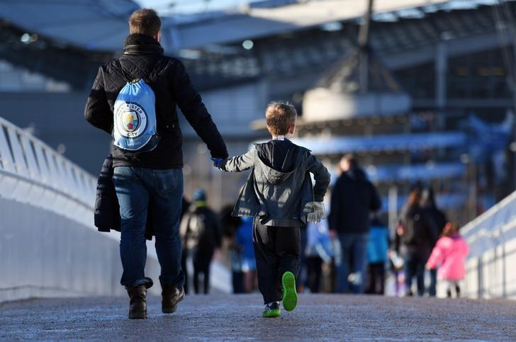 Britain Football Soccer - Manchester City v Burnley - Premier League - Etihad Stadium - 2/1/17 Manchester City fans outside the stadium before the match  Reuters / Anthony Devlin Livepic/File Photo