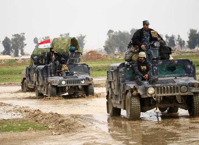Military vehicles of Iraqi federal police are seen during a battle between Iraqi forces and Islamic State militants, in Mosul, Iraq  March 17, 2017. REUTERS/Thaier Al-Sudani