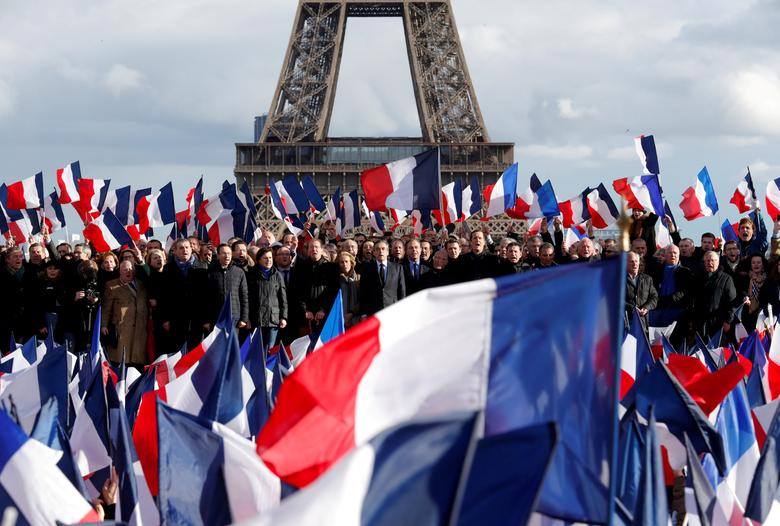 FILE PHOTO: Francois Fillon, former French prime minister, member of The Republicans political party and 2017 presidential election candidate of the French centre-right, attends a meeting at the Trocadero square across from the Eiffel Tower in Paris, France, March 5, 2017.  REUTERS/Philippe Wojazer/File Photo