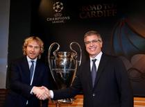 Juventus' Vice Chairman Pavel Nedved (L) shakes hands with FC Barcelona's Vice President Jordi Mestre after the draw of the UEFA Champions League quarterfinals in Nyon, Switzerland March 17, 2017. REUTERS/Denis Balibouse
