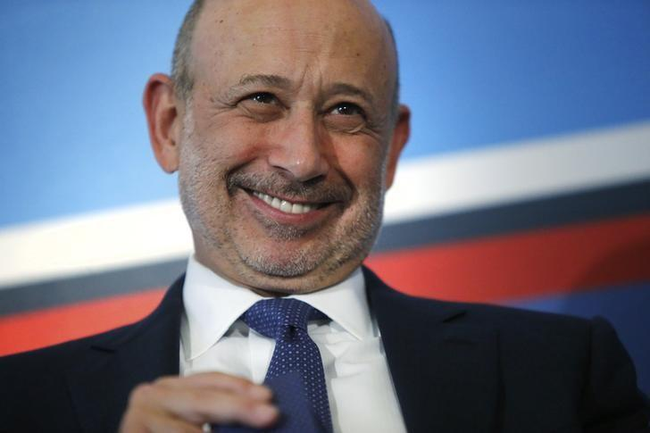 Goldman Sachs Group, Inc. Chairman and Chief Executive Officer Lloyd Blankfein smiles as he participates in a panel discussion during the White House Summit on Working Families in Washington June 23, 2014.  REUTERS/Jonathan Ernst/File Photo