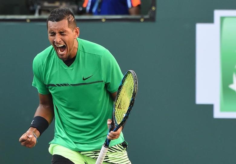 Mar 15, 2017; Indian Wells, CA, USA; Nick Kyrgios (AUS) reacts at match point as he defeats Novak Djokovic in the BNP Paribas Open at the Indian Wells Tennis Garden. Mandatory Credit: Jayne Kamin-Oncea-USA TODAY Sports