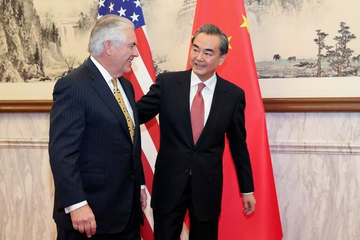 Chinese Foreign Minister Wang Yi (R) talks with U.S. Secretary of State Rex Tillerson at Diaoyutai State Guesthouse on March 18, 2017 in Beijing, China. REUTERS/ Lintao Zhang/POOL