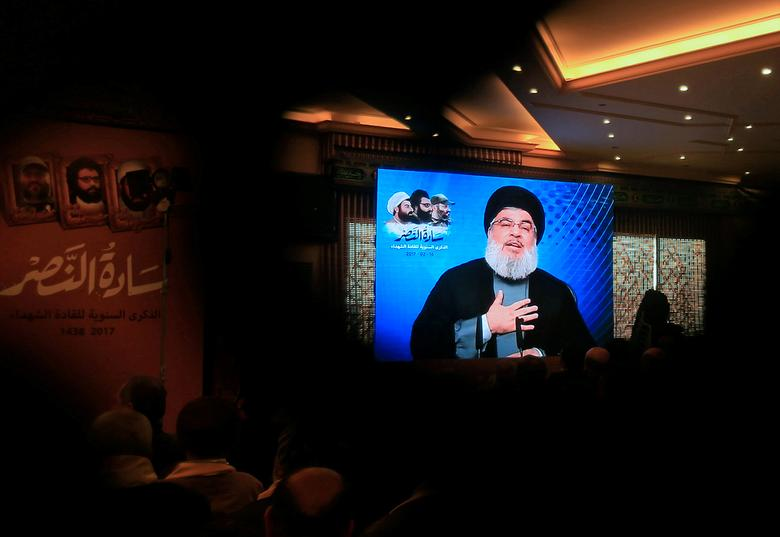 File photo: Lebanon's Hezbollah leader Sayyed Hassan Nasrallah addresses his supporters through a screen during a rally commemorating the annual Hezbollah Martyrs' Leaders Day in Jebshit village, southern Lebanon February 16, 2017. REUTERS/Ali Hashisho