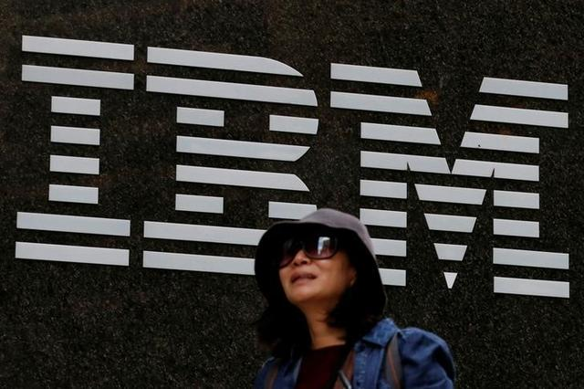 A woman passes by the IBM offices in New York City, U.S. on October 17, 2016.  REUTERS/Brendan McDermid/File Photo