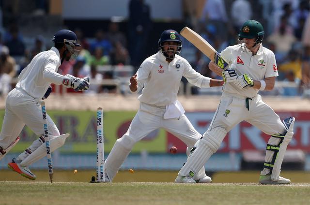 Cricket - India v Australia - Third Test cricket match - Jharkhand State Cricket Association Stadium, Ranchi, India - 20/03/17 - Australia's captain Steven Smith (R) is clean bowled. REUTERS/Adnan Abidi