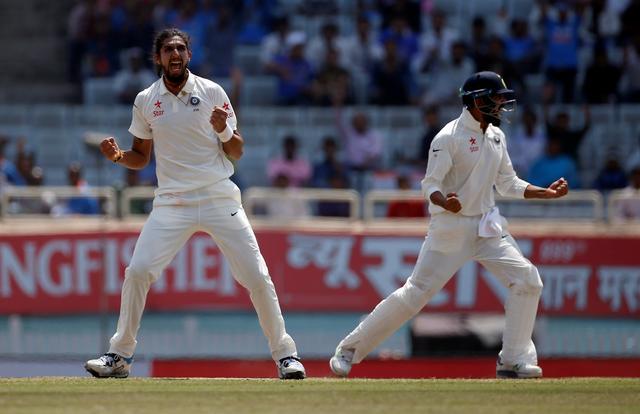 Cricket - India v Australia - Third Test cricket match - Jharkhand State Cricket Association Stadium, Ranchi, India - 20/03/17 - India's Ishant Sharma and Murali Vijay (R) celebrate the dismissal of Australia's Matt Renshaw. REUTERS/Adnan Abidi