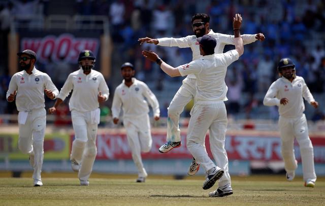 Cricket - India v Australia - Third Test cricket match - Jharkhand State Cricket Association Stadium, Ranchi, India - 20/03/17 - India's Ravindra Jadeja celebrates with his teammates after dismissing Australia's captain Steven Smith. REUTERS/Adnan Abidi
