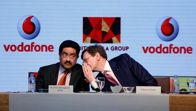 Kumar Mangalam Birla (L), chairman of Aditya Birla Group, listens to Vittorio Colao, CEO of Vodafone Group, during a news conference in Mumbai, India March 20, 2017. REUTERS/Danish Siddiqui