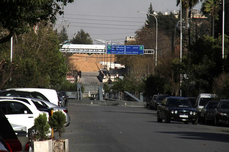 A road sign that shows the direction to Jobar district is pictured in the east of the capital Damascus, in this handout picture provided by SANA on March 19, 2017, Syria. SANA/Handout via REUTERS