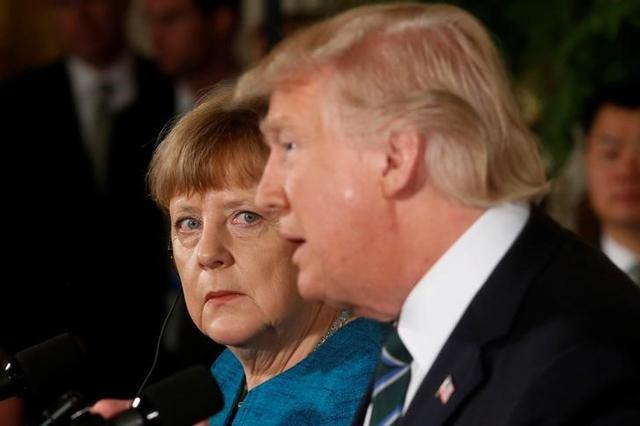 Germany's Chancellor Angela Merkel and U.S. President Donald Trump hold a joint news conference in the East Room of the White House in Washington, U.S., March 17, 2017. REUTERS/Jonathan Ernst