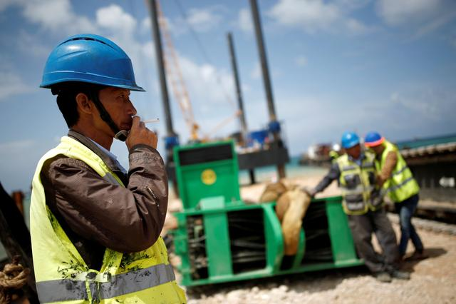FILE PHOTO: Chinese construction workers work during a media tour of the construction of a new port in the southern city of Ashdod, Israel April 12, 2016.  REUTERS/Amir Cohen/File Photo