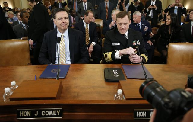 FBI Director James Comey (L) and National Security Agency Director Mike Rogers take their seats at a House Intelligence Committee hearing into alleged Russian meddling in the 2016 U.S. election, on Capitol Hill.   REUTERS/Joshua Roberts