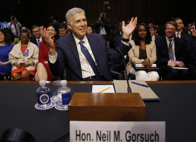 Supreme Court nominee judge Neil Gorsuch gestures as he arrives for his Senate Judiciary Committee confirmation hearing on Capitol Hill. REUTERS/Jonathan Ernst