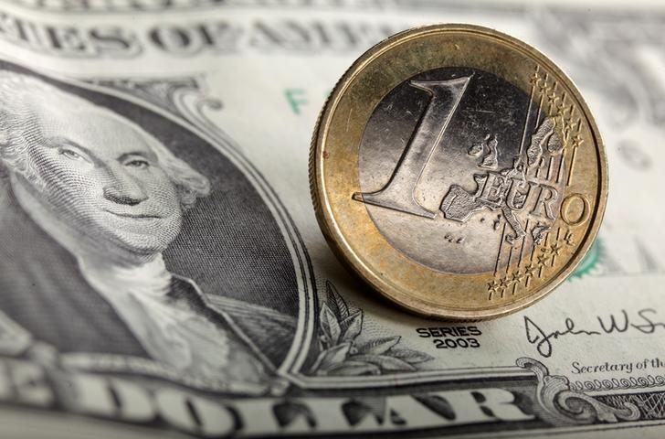 FILE PHOTO: A picture illustration taken on January 18, 2011, shows a 1 euro coin on one U.S. dollar banknotes.  REUTERS/Kacper Pempel/Illustration/File photo