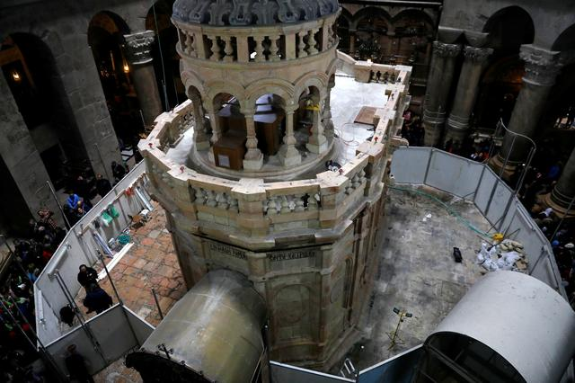 A view from above shows the newly restored Edicule, the ancient structure housing the tomb, which according to Christian belief is where Jesus's body was anointed and buried, seen upon completion of months of restoration works, at the Church of the Holy Sepulchre in Jerusalem's Old City March 20, 2017. REUTERS/Ronen Zvulun