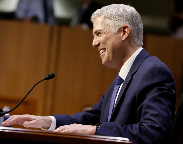 U.S. Supreme Court nominee judge Neil Gorsuch smiles at his Senate Judiciary Committee confirmation hearing on Capitol Hill in Washington, U.S., March 20, 2017. REUTERS/Joshua Roberts