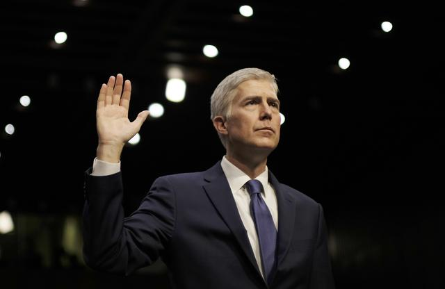 U.S. Supreme Court nominee judge Neil Gorsuch is sworn in to testify at his Senate Judiciary Committee confirmation hearing on Capitol Hill in Washington, U.S., March 20, 2017. REUTERS/James Lawler Duggan