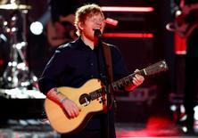 FILE PHOTO: British singer Ed Sheeran performs during the 'Golden Camera' ('Die Goldene Kamera') award ceremony of German TV magazine 'Hoer Zu' in Hamburg, March 4, 2017.  REUTERS/Christian Charisius/Pool/File Photo